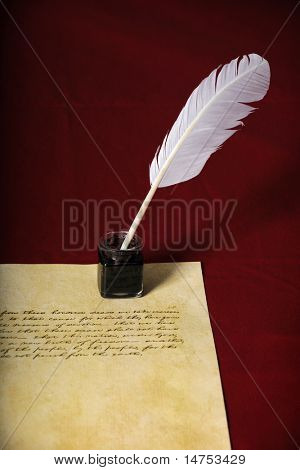 Quill, pen and handwritten text on parchment paper - Text is end of Abraham Lincoln's Gettysburg Address