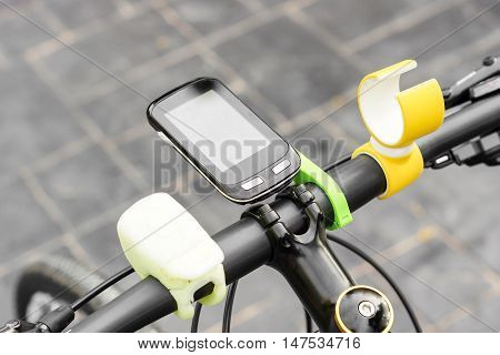 A smartphone installed on a bicycle's handlebar