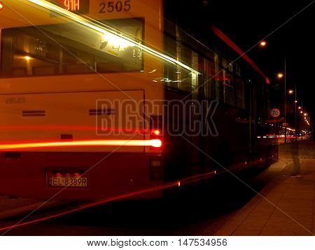 Night bus.  Lodz, Poland September 08, 2016The passenger in the shade and evening, blurred motion city bus, en route to the bus stop on the road leading from Lodz.