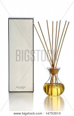 Scent diffuser over white background with reflections on table