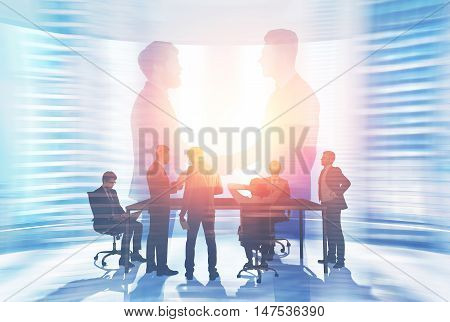 Portrait of two business leaders shaking hands and a bunch of ordinary workers negotiating at large table in conference room. Toned image. Double exposure