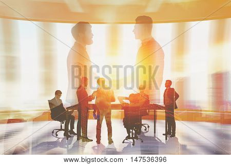 Portrait of two businessmen holding hands and a bunch of businesspeople negotiating in the background. Toned image. Double exposure.