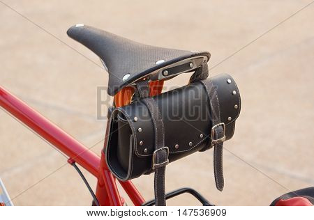A bicycle bag installed behind the saddle