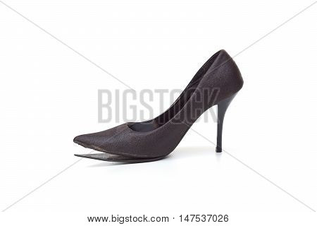 a worn out high heel shoe isolated