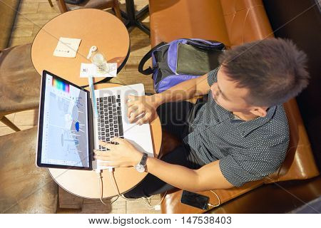 KUALA LUMPUR, MALAYSIA - MAY 09, 2016: man in a cafe at Suria KLCC. Suria KLCC is located in the Kuala Lumpur City Centre district. It is in the vicinity of the landmark the Petronas Towers.