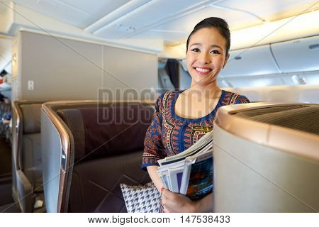 HONG KONG - CIRCA SEPTEMBER, 2016: Singapore Airlines crew member on board of Boeing 777. Singapore Airlines Limited is the flag carrier of Singapore which operates from its hub at Changi Airport