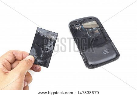Smartphone with battery problem / Hand holding a mobile phone battery burn due to overheat