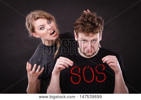 Young Couple With Broken Heart And Sos Word.