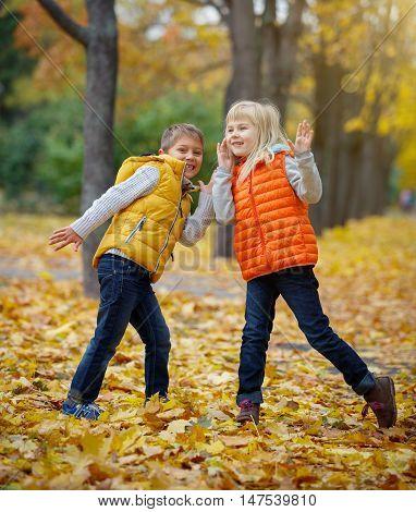 Happy Kids walking in beauty Autumn Park
