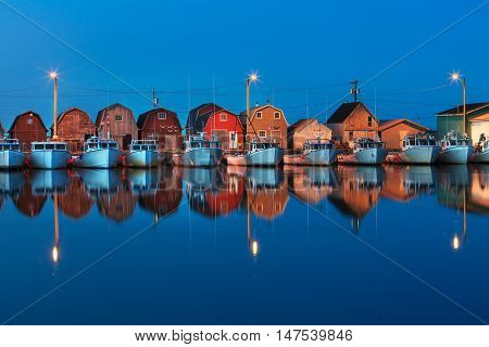 Lobster boats at twilight tied up at Malpaque Wharf, Prince Edward Island, Canada.