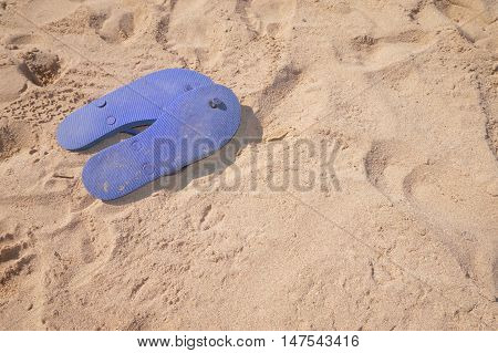 Flip Flops Upturned On Beach Sand With Copy Space
