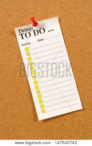 To Do List pinned to a cork bulletin board