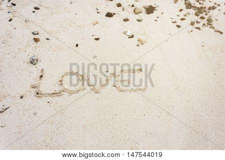 love message written in sand Sign Love on sand on beach