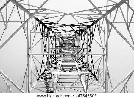 Newly completed telecommunication tower with white and red paint step ladder in black and white format