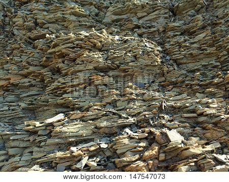 Mountain textured rocky wall with layered stone structure