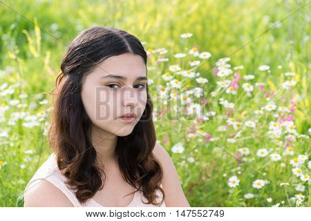Portrait of a sad teen girl on nature