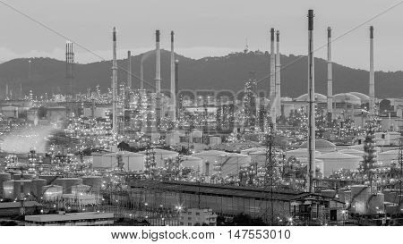 Black and White, Oil refinery with mountain background at night