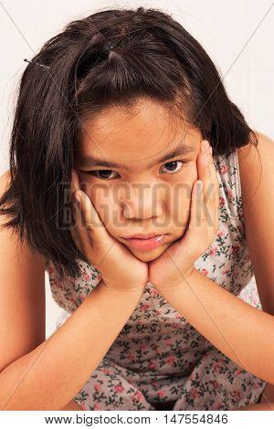 portrait of cute girl sad and morose
