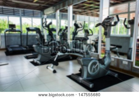 blurry of fitness room dumbbell for healthy