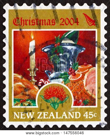NEW ZEALAND - CIRCA 2004: a stamp printed in New Zealand shows Candle Wine Bottle Turkey and Ham Christmas circa 2004
