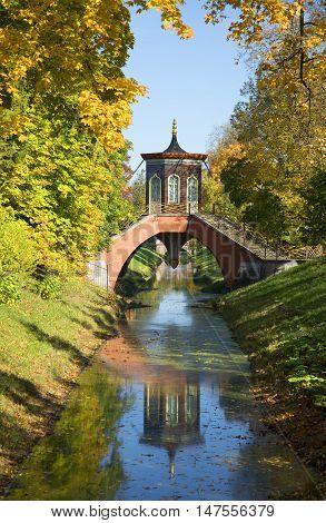 SAINT PETERSBURG, RUSSIA - OCTOBER 02, 2014: Cross bridge in the fall. Alexander Park of Tsarskoye Selo. Historical landmark of the city Saint Petersburg
