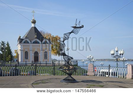 RYBINSK, RUSSIA - SEPTEMBER 04, 2015: The monument to fishermen and the chapel of St. Nicholas on the Volga embankment. Historical landmark of the city Rybinsk