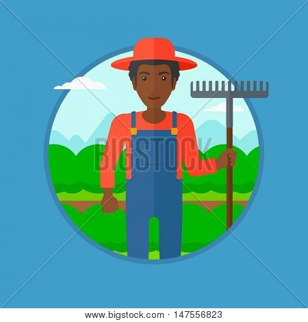 An african-american farmer standing with a rake at cabbage field. Young male farmer holding rake and working in cabbage field. Vector flat design illustration in the circle isolated on background.