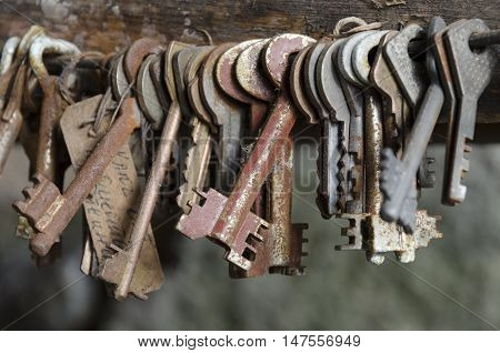 The collection of old rusty keys in bunch