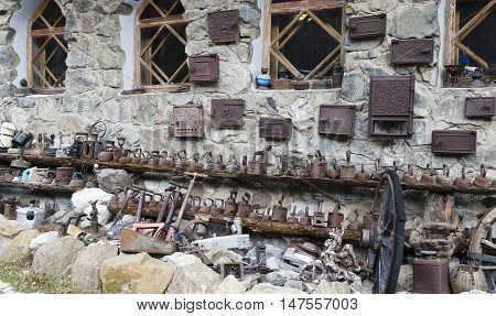 The collection of old vintage things on the wall of residential house in Russia