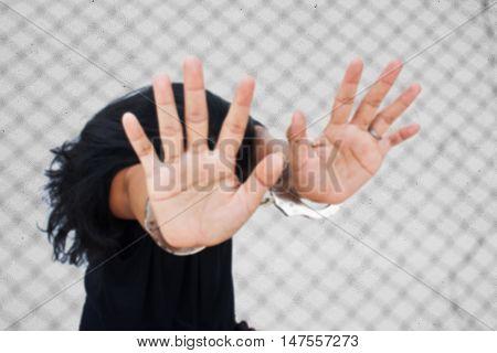 blurry -SlaveHuman Trafficking conceptwomen hand in handcuff
