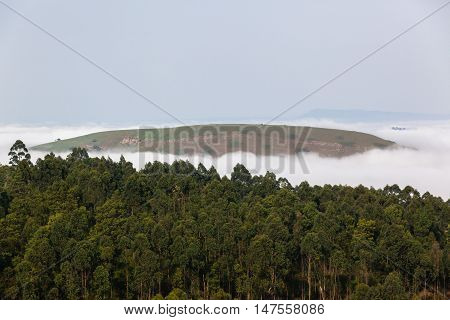 Cloud blanket mist moves through valley hills countryside farmland scenic landscape