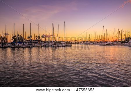 Beautiful view of Ala Wai Harbor at twilight. Ala Wai Harbor is the largest small-boat and yacht harbor in Hawaii.