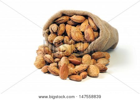 Group of Almond in shell and shelled in burlap sack isolated on white background nut vegetarians food.