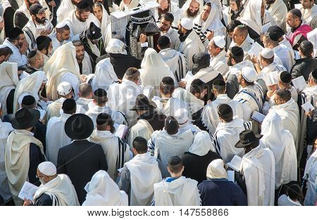 UMAN, UKRAINE - SEPTEMBER 15, 2015: People praying during celebration of Rosh Hashanah. Nearly 30,000 Jews have flocked to the Ukrainian town of Uman to celebrate Rosh Hashanah, the Jewish New Year.