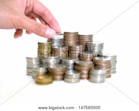 Saving money concept. Woman hand put coins to stack of coins. Savings Finance Business Investment Growth Concept. (selective focus)