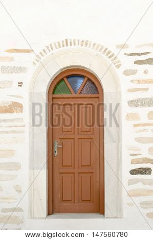 Arched doorway of the local church of Marpissa village at Paros island.