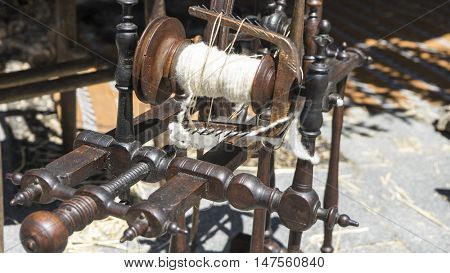 Retro, traditional spinning wheel for wool yarn, craft ancient instrument