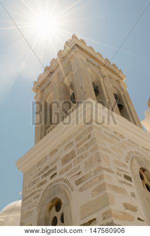 Marpissa's village local church at Paros island in Greece against the sun.