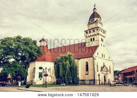 Parish church of saint archangel Michael and funeral chapel of saint Anna Skalica Slovak republic. Retro photo filter.