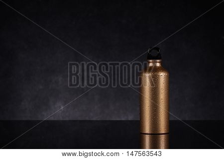 A stainless steel bottle isolated in black background