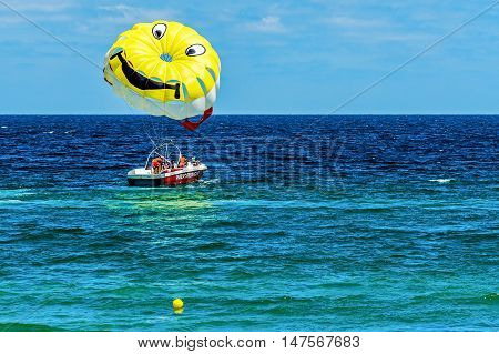 SOZOPOL, BULGARIA - JULY 16, 2016: Tourists practice parasailing in Sozopol, one of the oldest Bulgarian towns, founded in the 7th century BC, nowadays one of the major seaside resorts in the country.