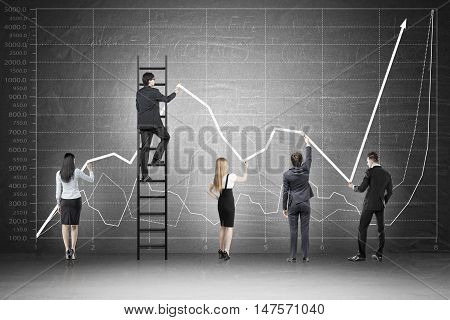 Rear view of business team standing against blackboard with graphs on it drawing. Concept of everyone's contribution to firm's success.