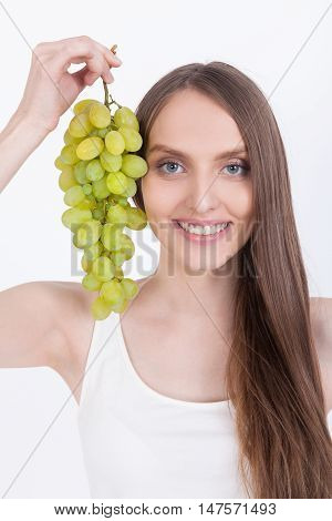 Smiling Girl In White Tank Top With Grapes
