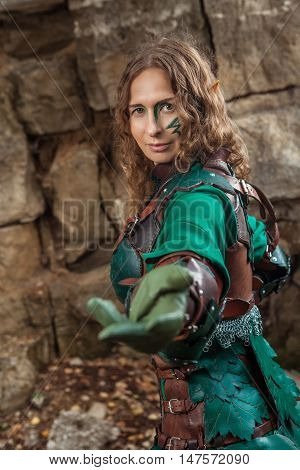 Elf Woman In Green Leather Armor Is Inviting You.