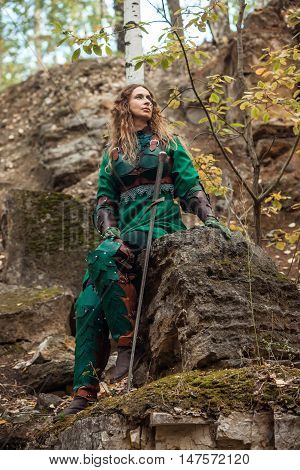 Elf Woman In Green Leather Armor With The Sword