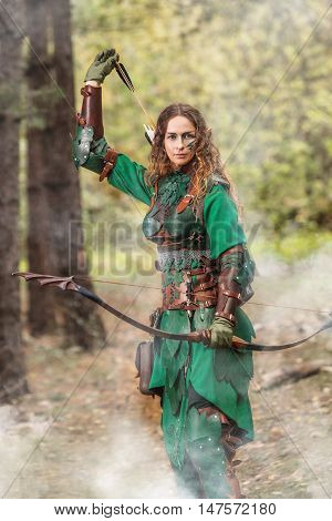 Elf Woman In Green Leather Armor With The Bow And Arrows