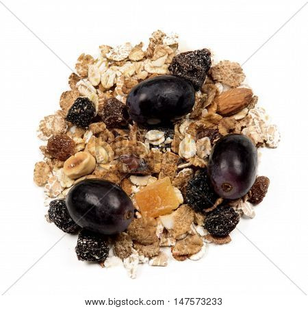 organic muesli with red grapes isolated on white background