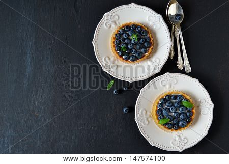 Tartlets with meringue and strawberries with space for text