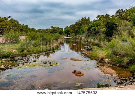 A Rocky Texas Creek With Wildflowers.