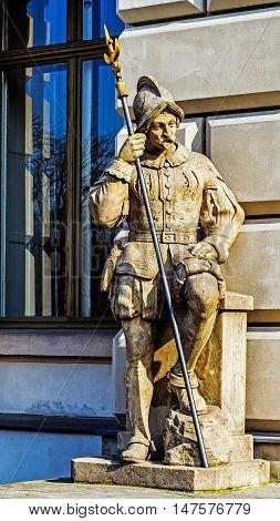 Halberdier statue next to the neo-baroque castle in Pszczyna Silesia region Poland.